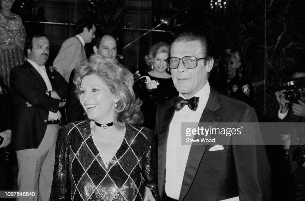 English actor Roger Moore and Italian actress Luisa Mattioli attend gala dinner to honour Prince Andrew by the British Olympic Association at the at...