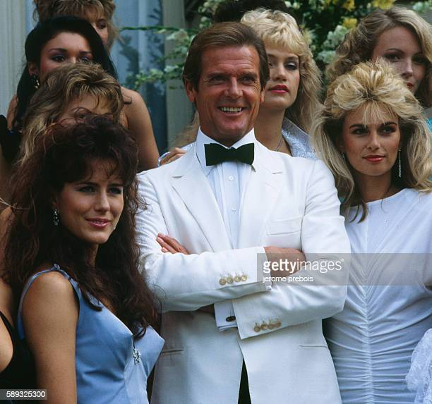 English actor Roger Moore and the James Bond Girls for the presentation of the film A View to Kill