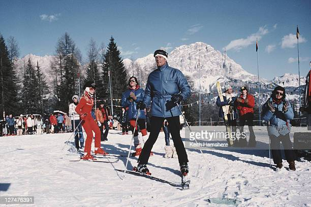 English actor Roger Moore as 007 with American ice skating champion LynnHolly Johnson as Bibi Dahl in a scene from the James Bond film 'For Your Eyes...