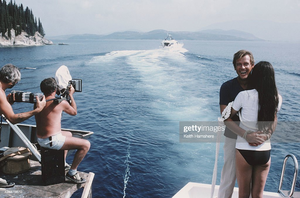 English actor Roger Moore as 007 with French actress Carole Bouquet as Melina Havelock on the set of the James Bond film 'For Your Eyes Only', February 1981. Here they are tied together in readiness for a scene in which they are dragged through shark-infested waters.