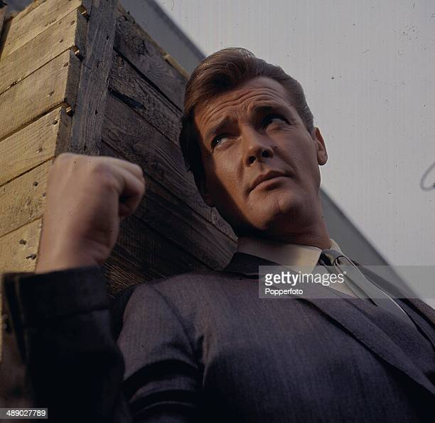 English actor Roger Moore in character as 'Simon Templar' in a scene from the television series 'The Saint' in 1967