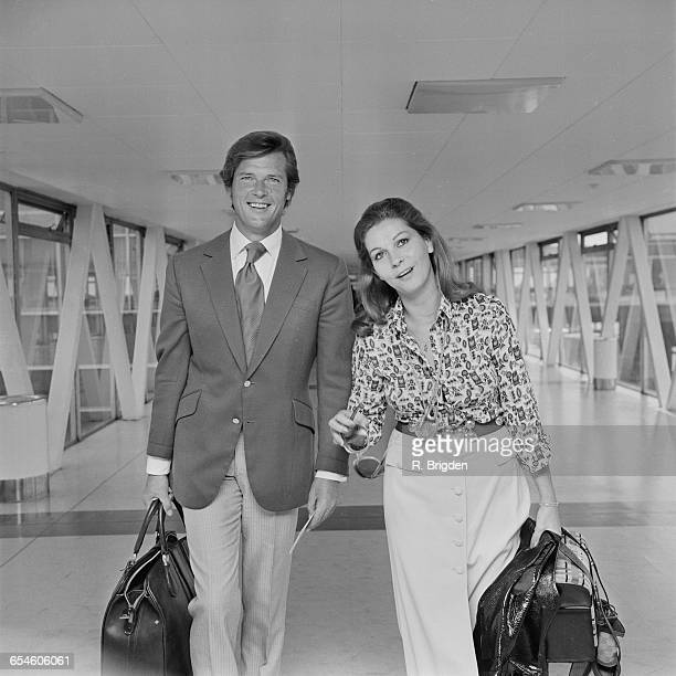 English actor Roger Moore leaves London Airport for America accompanied by his wife Luisa Mattioli UK 15th July 1971