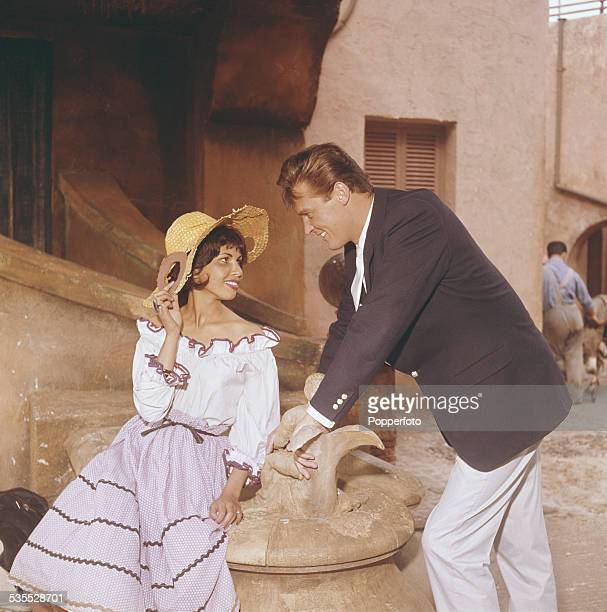 English actor Roger Moore pictured in character as Simon Templar in a scene from the television drama series 'The Saint' at Elstree Studios in...