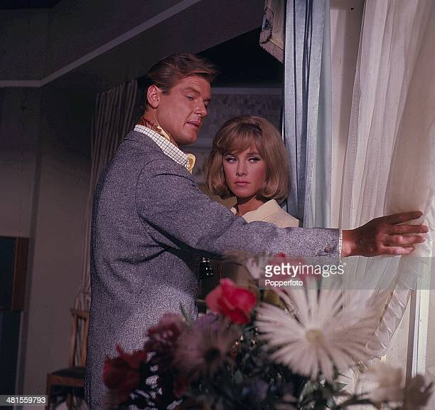 1968 English actor Roger Moore pictured with actress Wanda Ventham in a scene from the television series 'The Saint' in 1968