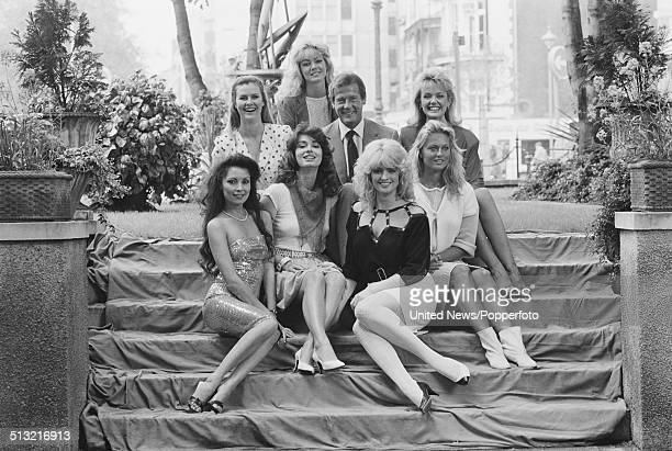 English actor Roger Moore posed with Bond girls Joni Flynn Janine Andrews Carole Ashby Carolyn Seaward Alison Worth Mary Stavin and Tina Robinson at...