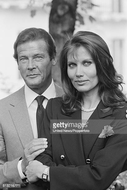 English actor Roger Moore posed with Swedish actress Maud Adams at a press call to promote the James Bond film Octopussy in London on 1st June 1983
