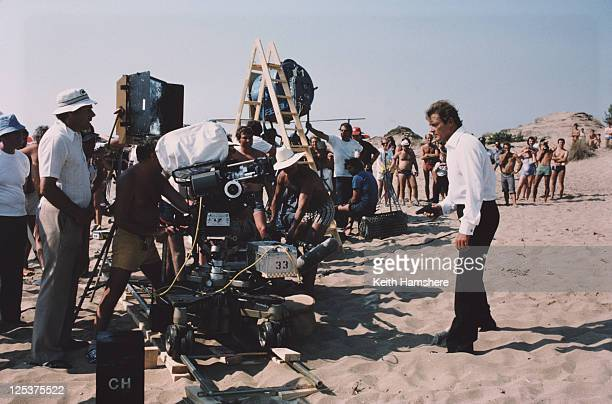 English actor Roger Moore stars as 007 in the James Bond film 'For Your Eyes Only' November 1980 Here they film a beach scene on location