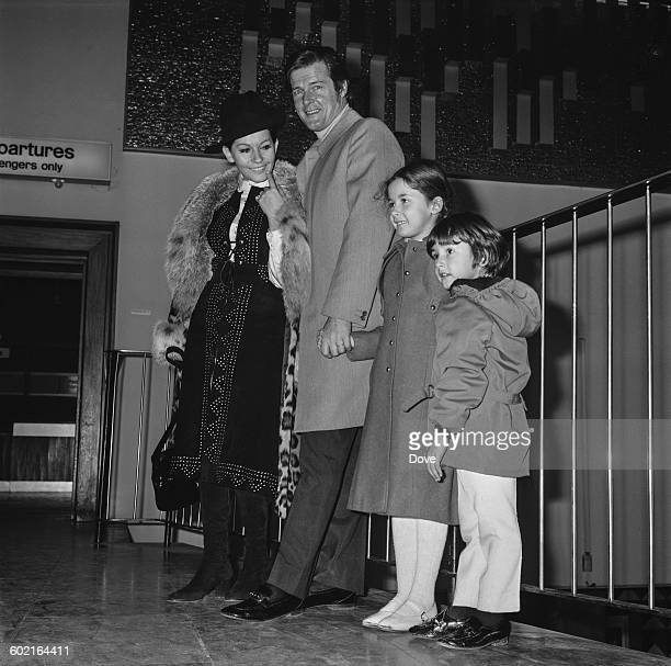 English actor Roger Moore with his wife Luisa Mattioli and their children at London Airport UK 16th January 1971 Their daughter Deborah later became...