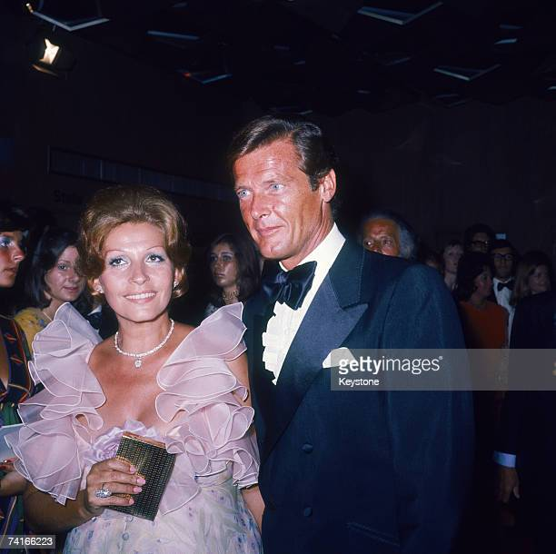 English actor Roger Moore with his wife Luisa Mattioli at the premiere of the James Bond film 'Live and Let Die' directed by Guy Hamilton London 5th...