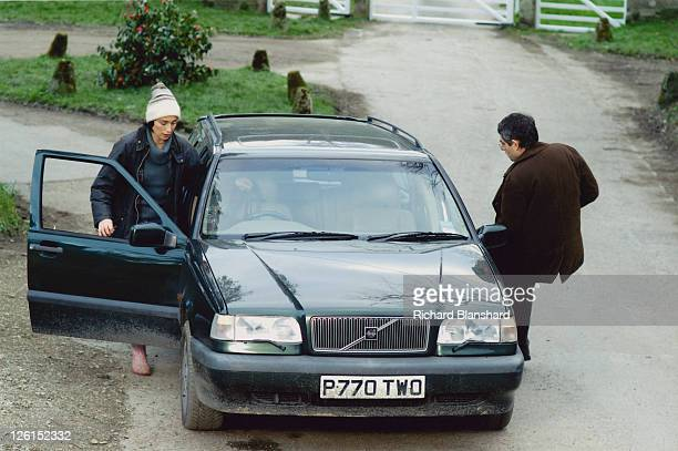 English actor Rowan Atkinson stars as vicar Walter Goodfellow with actress Kristin Scott Thomas as his wife Gloria in the British black comedy...