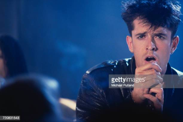 English actor Rupert Everett singing during a video shoot for Richard Marquand's musical drama 'Hearts Of Fire' 21st May 1987