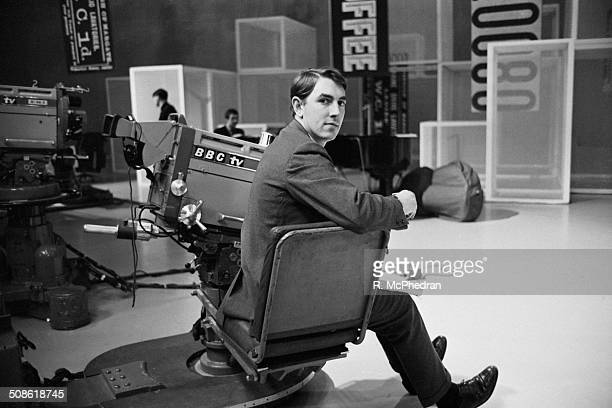English actor satirist writer and comedian Peter Cook poses in a BBC studio 29th November 1964