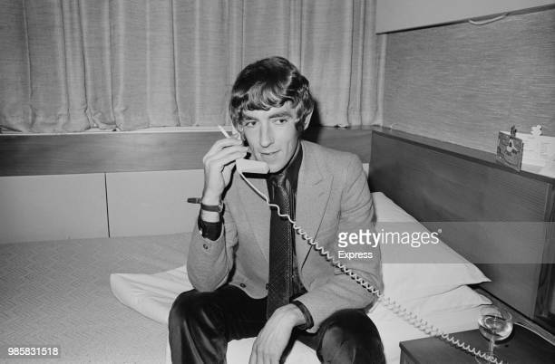 English actor satirist writer and comedian Peter Cook using phone in an hotel room UK 20th March 1969