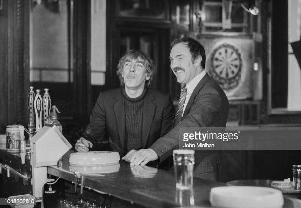 English actor satirist writer and comedian Peter Cook with English soccer player Jimmy Greaves at a pub UK 18th January 1980