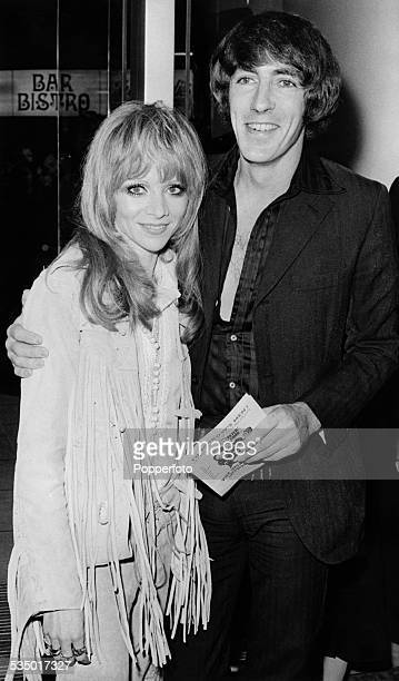 English actor satirist writer and comedian Peter Cook with English actress Judy Huxtable at the premiere of 'The Rise and Rise of Michael Rimmer'...