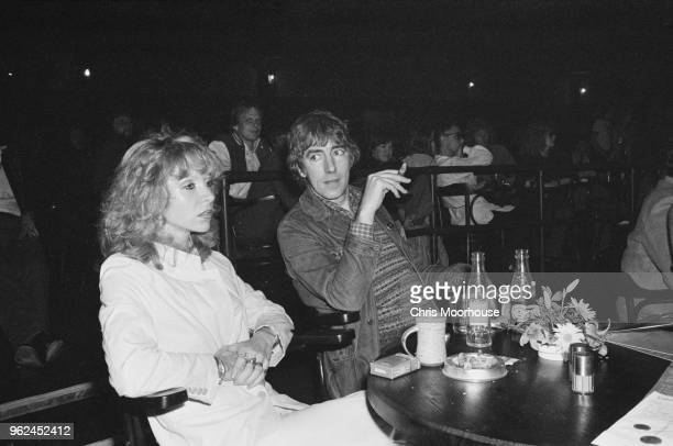 English actor satirist writer and comedian Peter Cook with his wife English actress Judy Huxtable at The Venue London UK 2nd November 1978
