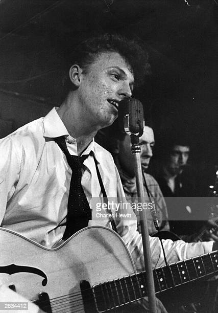English actor, singer and director Tommy Steele playing the guitar and singing in a live performance at the Cat's Whisker club, Soho. Original...