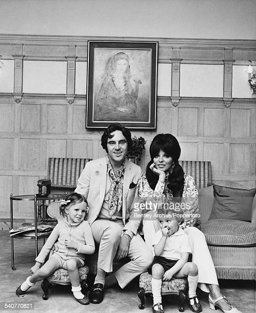 English actor singer and songwriter Anthony Newley and his wife English actress Joan Collins at home with their children Tara and Sacha 19th July 1968