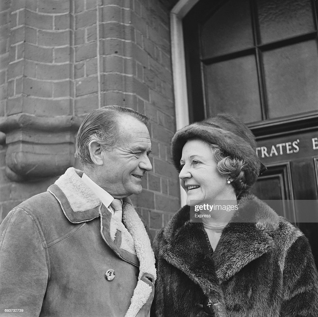 English actor Sir John Mills (1908 - 2005) and his wife, actress and writer Mary Hayley Bell (1911 - 2005) outside Richmond Magistrate's Court where she was sworn in as a new magistrate on the bench, London, 1st February 1965.