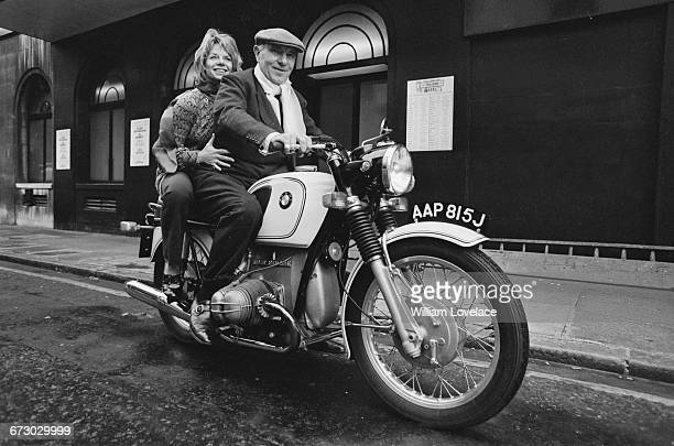 English actor Sir Ralph Richardson gives actress Jill Bennett a lift on his motorcycle UK 4th October 1971