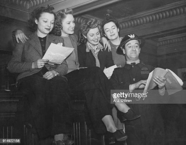 English actor Stanley Lupino temporarily an ARP warden in Streatham London goes through the script for his pantomime 'Mother Goose' at the Streatham...