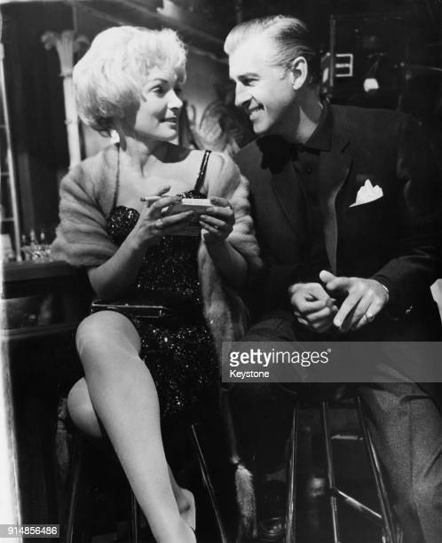English actor Stewart Granger with actress Delphi Lawrence on the set of the film 'Sleeping Partner' at Elstree Studios UK 13th August 1960 Granger's...