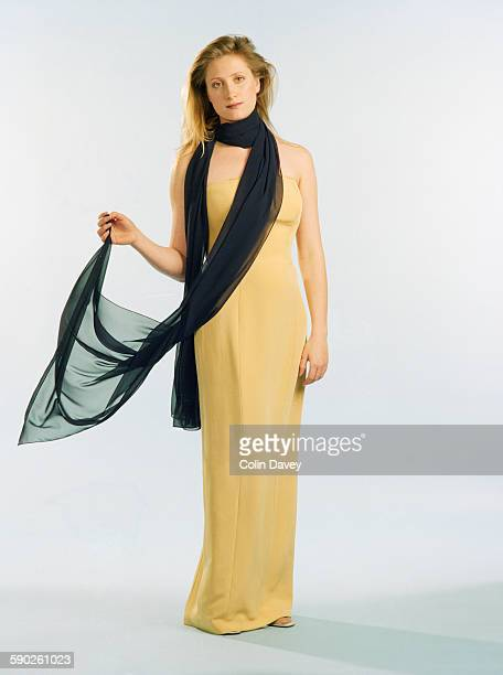 English actor Susannah Harker wearing a sleeveless yellow evening gown and a fine black shawl 20th May 1996
