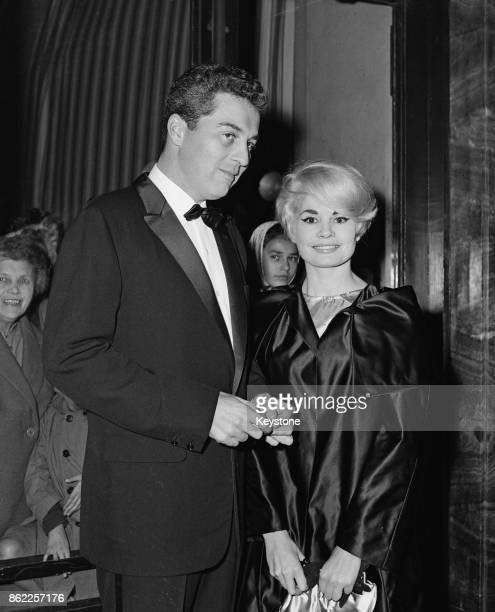 English actor Sydney Chaplin and his partner Noelle Adam attend the gala premiere of the film 'Le miroir à deux faces' at the Palais de Chaillot,...