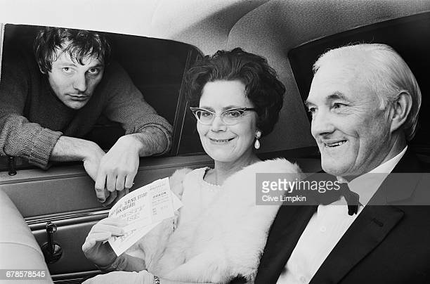 English actor Terence Stamp sees his parents Ethel and Thomas off to the London premiere of his latest film 'Modesty Blaise' UK 5th May 1966