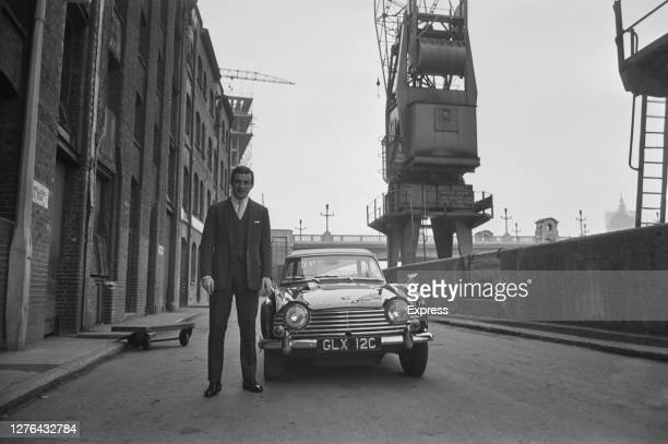 English actor Tom Adams with a Triumph car UK 1966