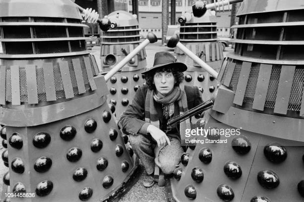 English actor Tom Baker as the 'Doctor' with Daleks on the set of British television series 'Doctor Who', UK, 5th March 1975.