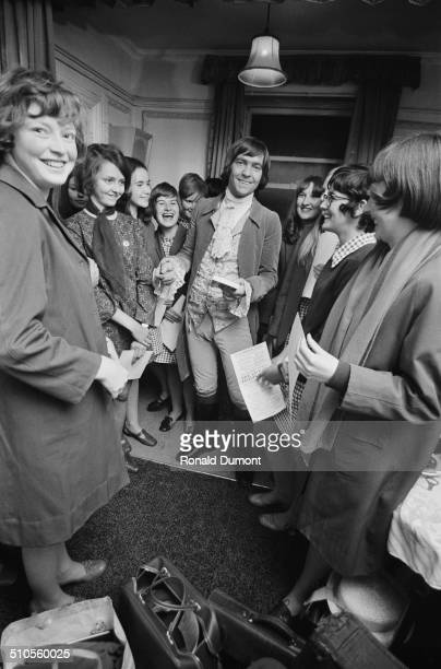 English actor Tom Courtenay is surrounded by autograph hunters in his dressing room 22nd August 1969