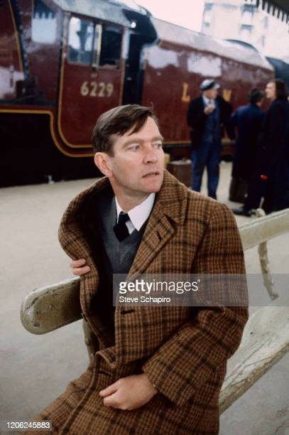 English actor Tom Courtenay sits on a bench during the filming of his movie 'The Movie' , England 1982. Courtenay originated the role in the stage...