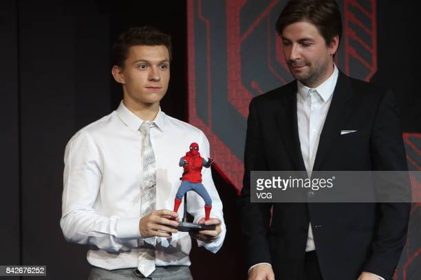 English actor Tom Holland and American director Jon Watts attend the premiere of film SpiderMan Homecoming on September 4 2017 in Beijing China