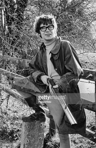 English actor Tom Owen holds a doublebarreled shotgun during a shooting trip in woodland in April 1968 Tom Owen currently plays the role of Bill...