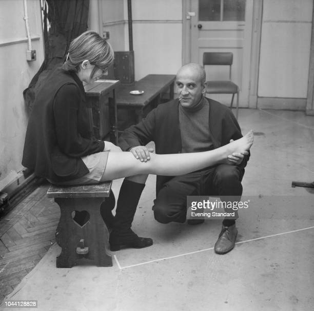 English actor Warren Mitchell checking the leg of English actress Frances de la Tour with UK 13th February 1969