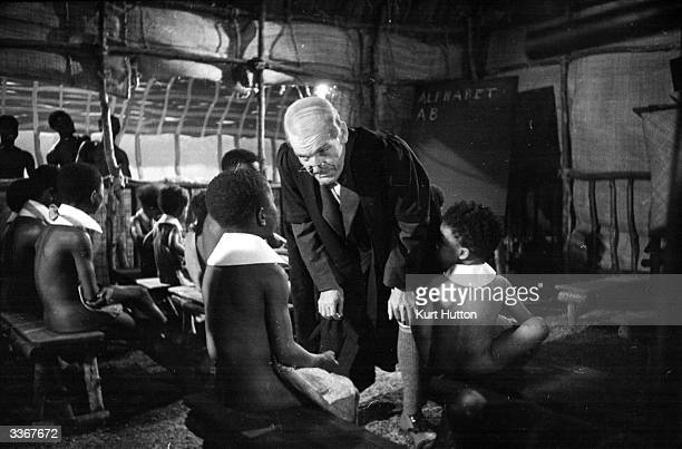 English actor Will Hay plays Professor Benjamin Tibbetts in the film 'Old Bones of the River' directed by Marrcel Varnel and produced by Gainsborough...