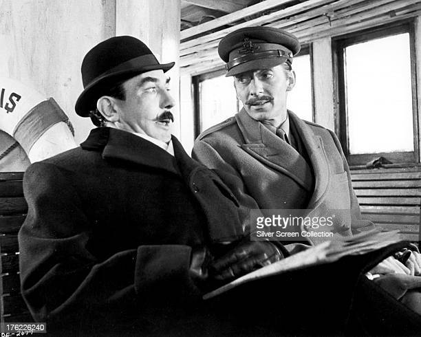 English actors Albert Finney as Hercule Poirot, and Jeremy Lloyd as the aide de camp in 'Murder On The Orient Express', directed by Sidney Lumet,...