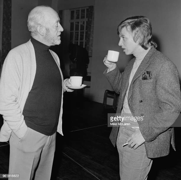 English actors Alec Guinness and Tommy Steele chat over a cup of tea during rehearsals for the ATV television production of Shakespeare's 'Twelfth...