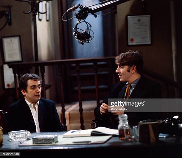 English actors and comedians Dudley Moore on left and Peter Cook pictured together in a sketch for television in 1966
