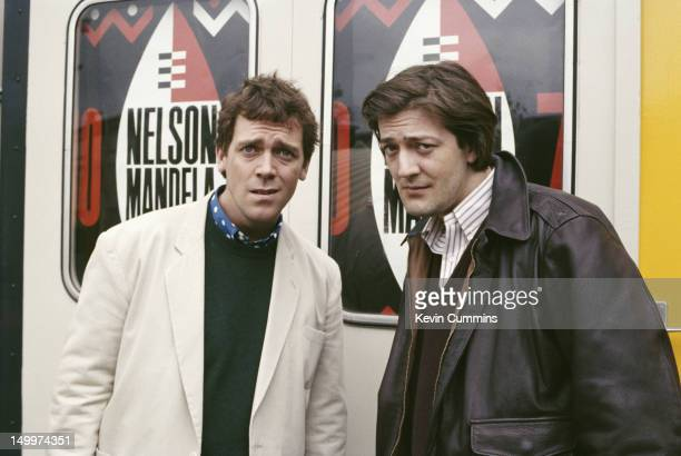 English actors and comedians Stephen Fry and Hugh Laurie of comedy double act Fry And Laurie at the Nelson Mandela 70th Birthday Tribute Wembley...