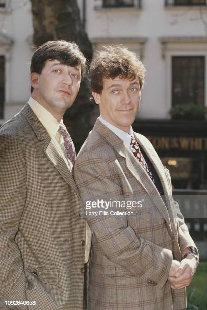English actors and comedians Stephen Fry, on left and Hugh Laurie, who appear together in the comedy television series 'A Bit of Fry & Laurie', posed...