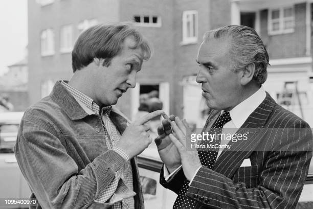 English actors Dennis Waterman as 'Terry McCann' and George Cole as 'Arthur Daley' on the set of comedydrama television series 'Minder' UK 20th...