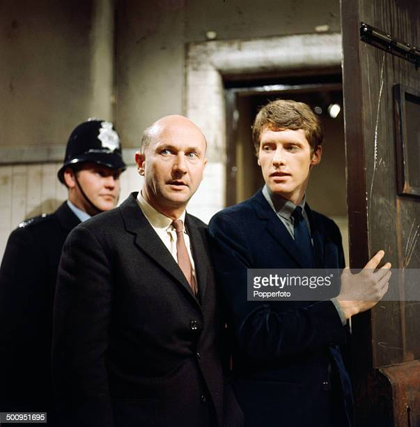 English actors Donald Pleasence in centre and Michael Crawford pictured in a scene from the television drama 'The Move After Checkmate' in 1966