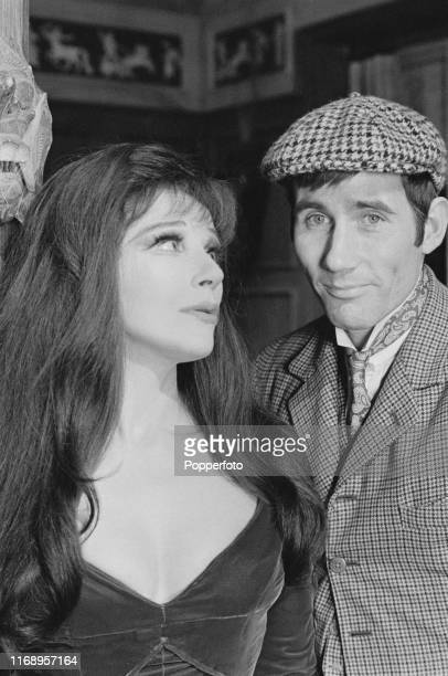 English actors Fenella Fielding and Jim Dale in character as Valeria Watt and Albert Potter on set during production of the film 'Carry On Screaming'...