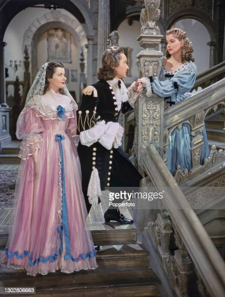 English actors, from left, Margaret Lockwood in character as Barbara Worth, Griffith Jones as Sir Ralph Skelton and Patricia Roc as Caroline in a...