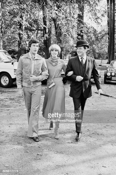 English actors Gareth Hunt Joanna Lumley and Patrick Macnee posed together at a press reception to launch the television series The New Avengers at...