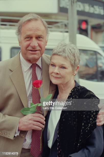 English actors Geoffrey Palmer and Judi Dench attend a photocall to launch the new series of the BBC Television sitcom 'As Time Goes By' in London in...