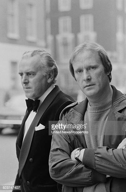 English actors George Cole and Dennis Waterman pictured together in character as Arthur Daley and Terry McCann during filming of the television...