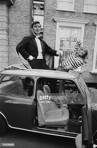 English actors Gerald Harper and Juliet Harmer in London during filming of the BBC TV adventure series 'Adam Adamant Lives' 19th May 1966 Harper...